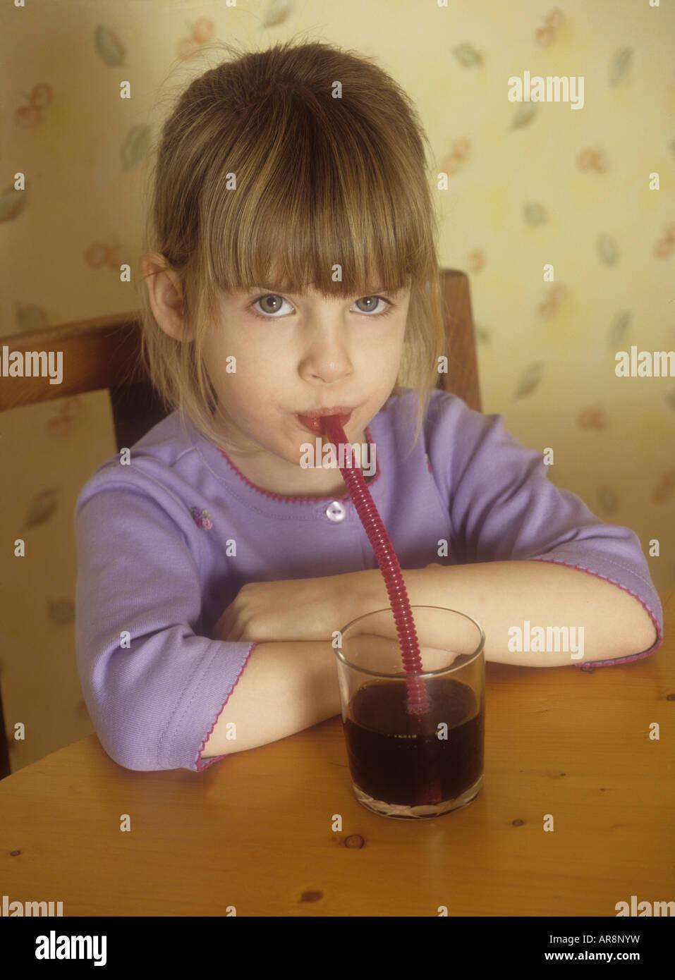 Young girl drinking coke - Stock Image