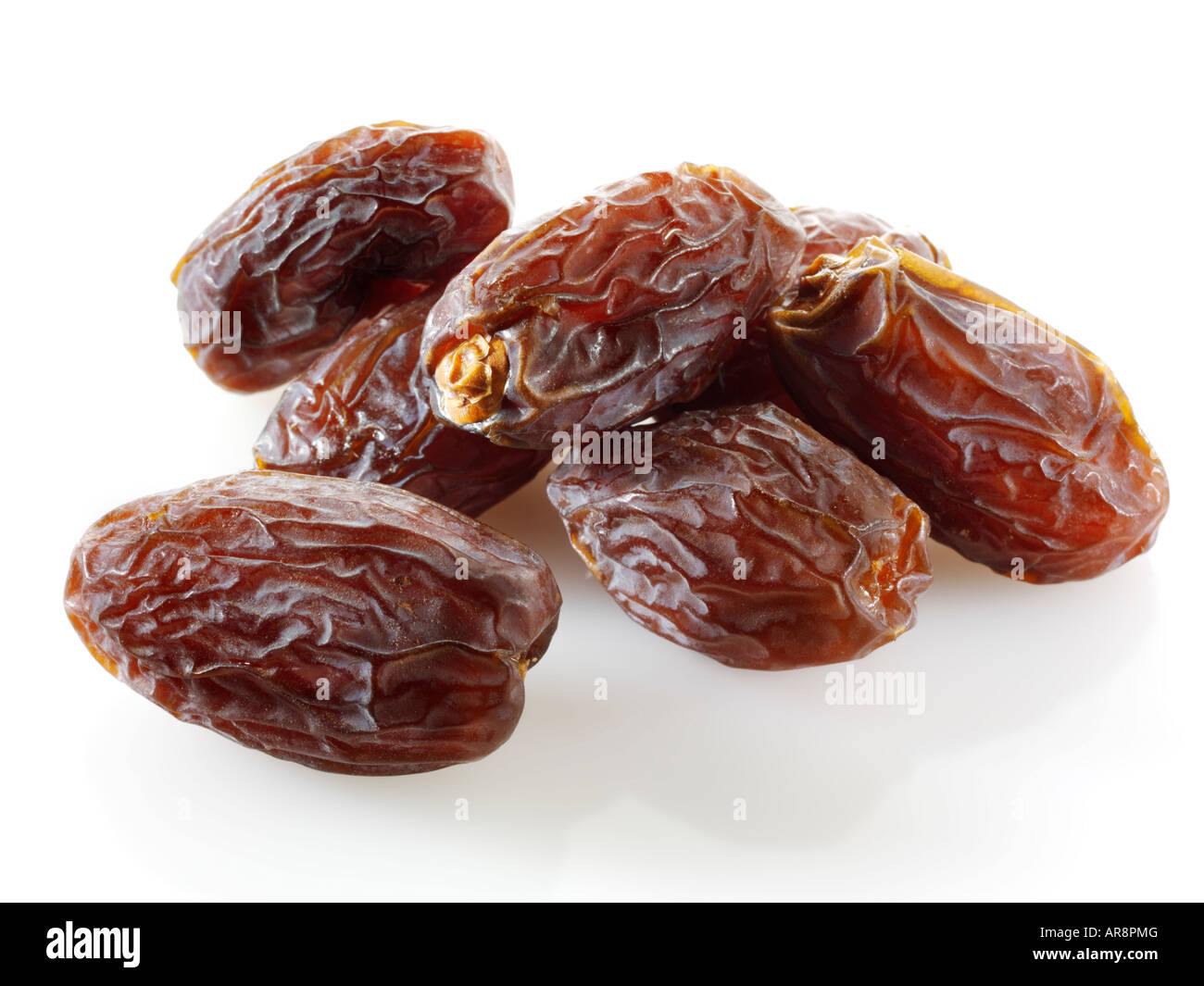 Fresh whole dried dates Fresh whole dates against a white background for cut out - Stock Image