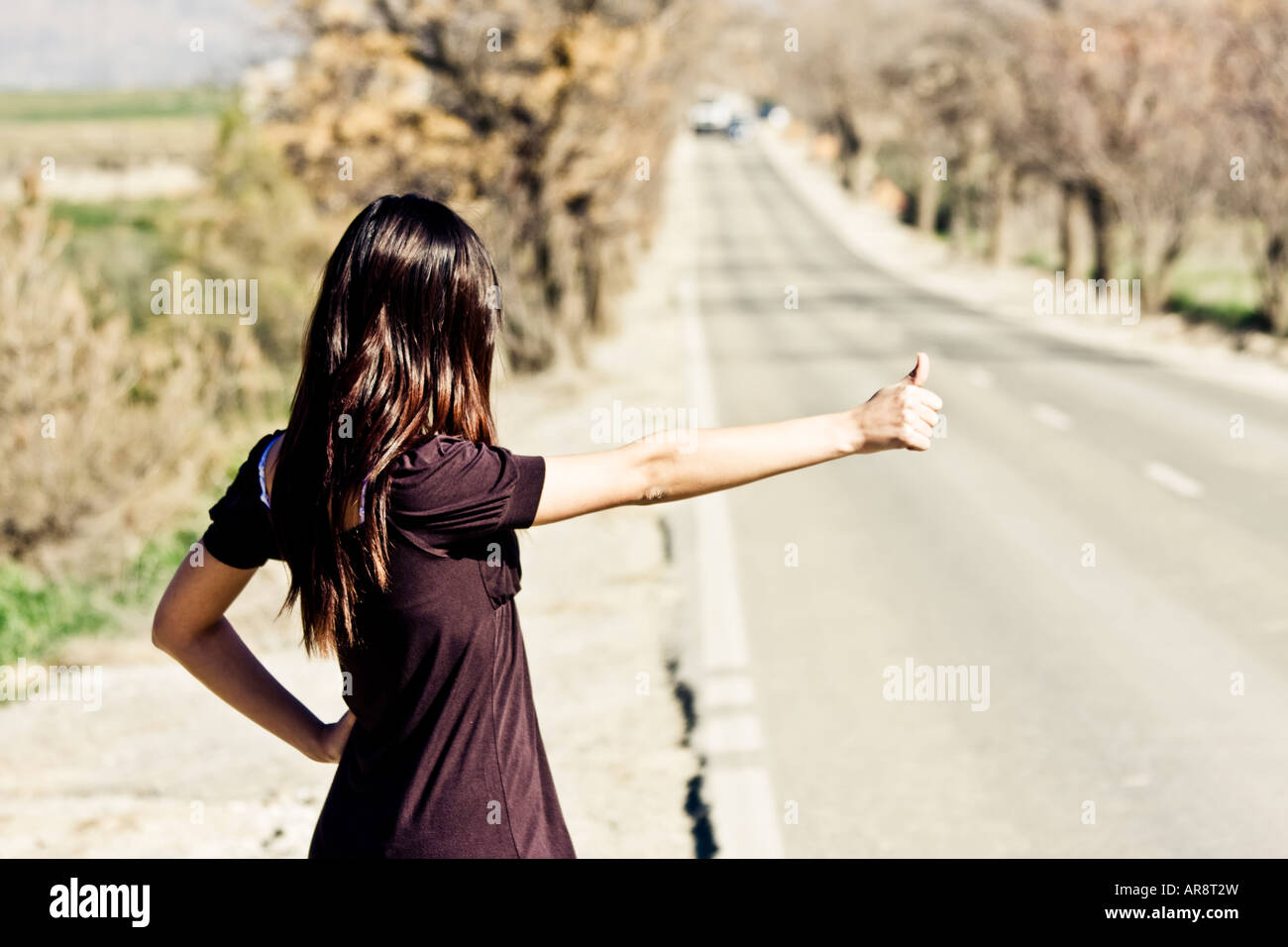 Hitchhikers By Side Of Road >> Hitchhiker Woman Waiting At One Side Of The Road Stock Photo