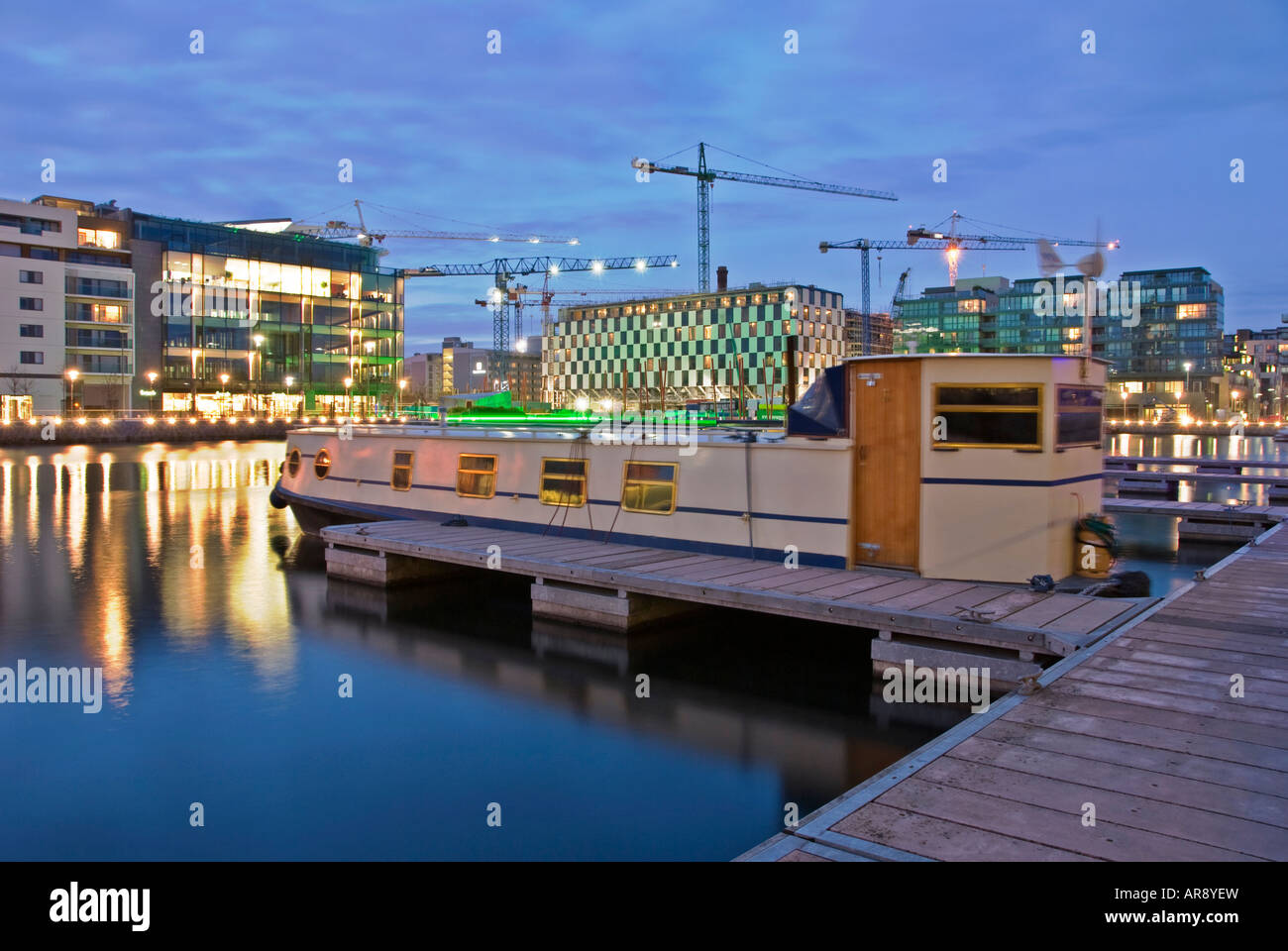A Canal Barge Moored at the Charlotte Quay Marina, Grand Canal Docks, Dublin - Stock Image