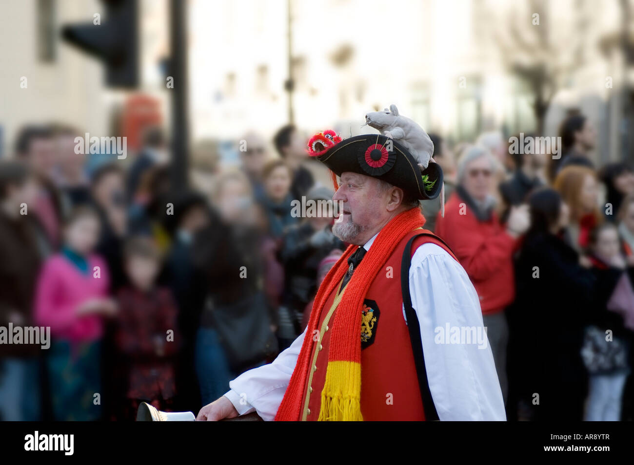 chinese new year celebrations the strand london 2008, town crier with a rat on his hat - Stock Image