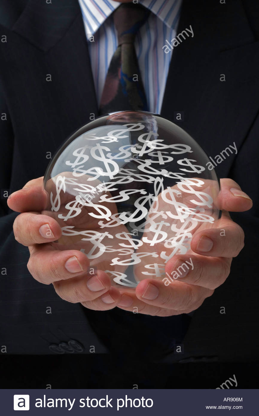 Businessman holding a crystal ball predicting the future of the US. dollar. - Stock Image