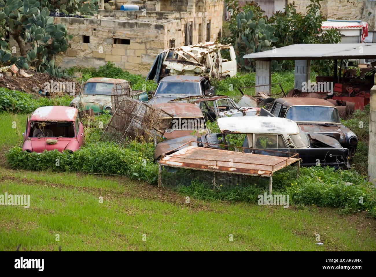 classic cars in scrap yard malta old maltese junk Stock Photo ...
