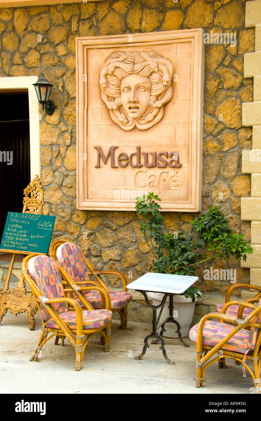 An outdoor restaurant with table and chairs at Finikouda Messinia Peloponesse Greece - Stock Image