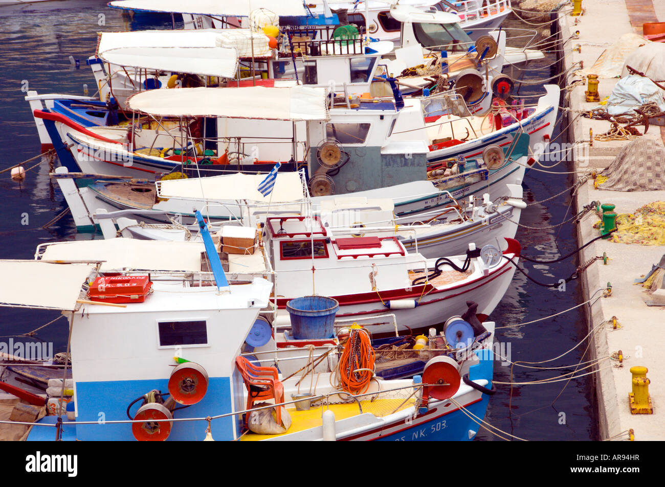 Colorful fishing boats in port at Finikouda Messinia Peloponesse Greece - Stock Image