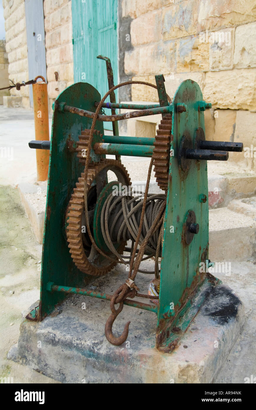 winch cable gear mesh hook lifting gear dockside - Stock Image