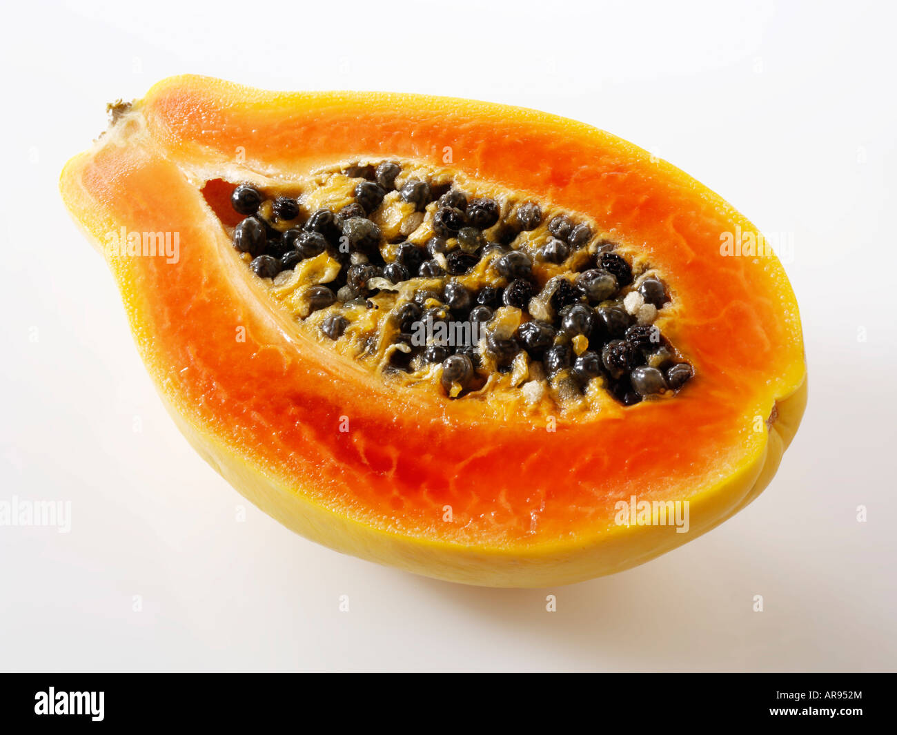 Papaya Tropical Fruit Cut In Half Against A White Background As A