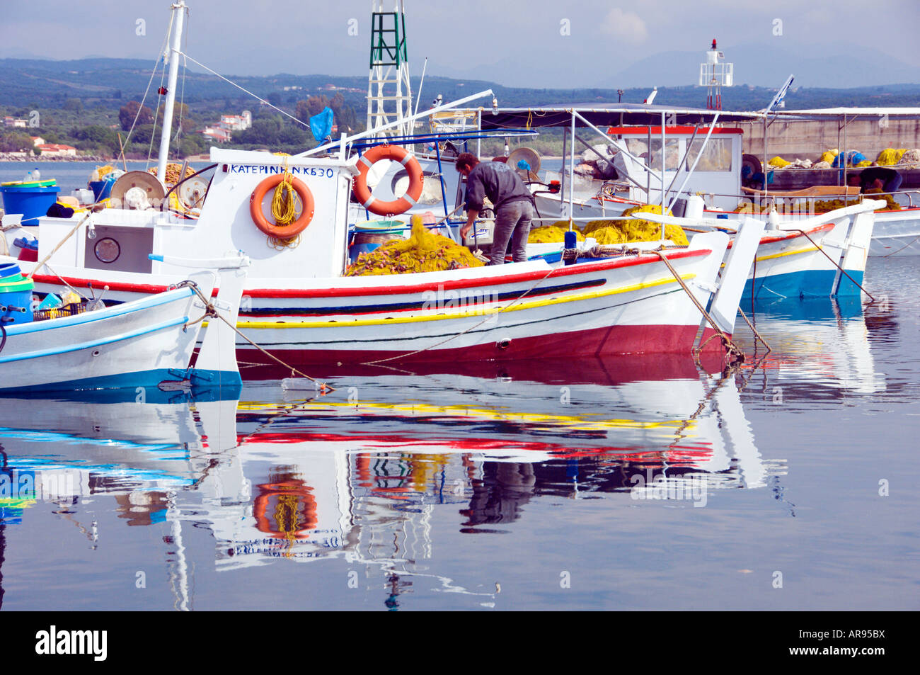 Colorful fishing boats in the small village of Pitalidi Peloponesse Greece - Stock Image