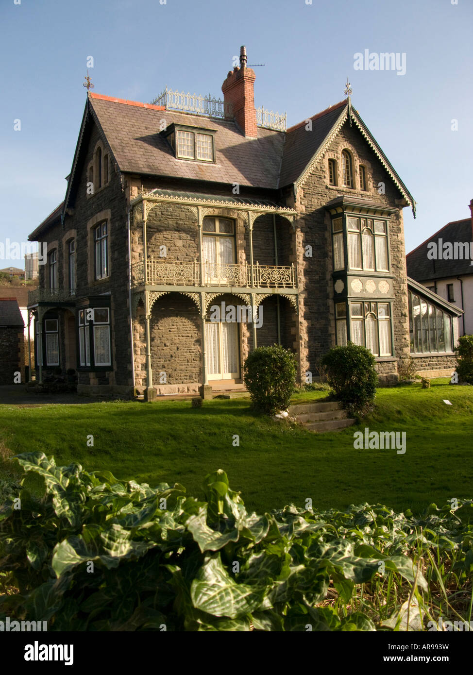 Victorian Gothic Villa Detached House Home Property With Wrought Iron Balcony Aberystwyth Wales Uk Stock