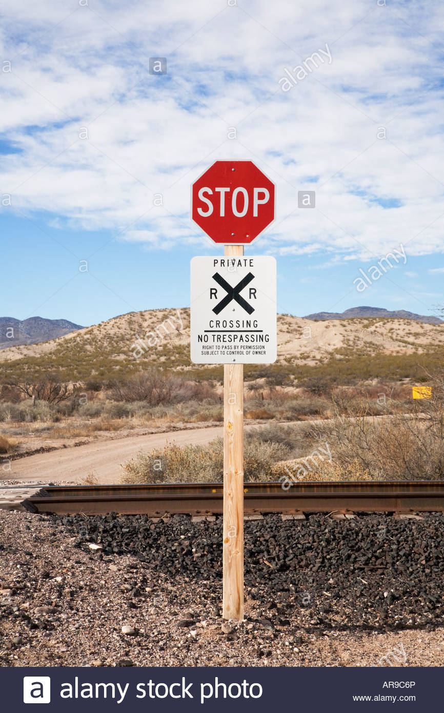 Highway signs stop railroad crossing unguarded crossing