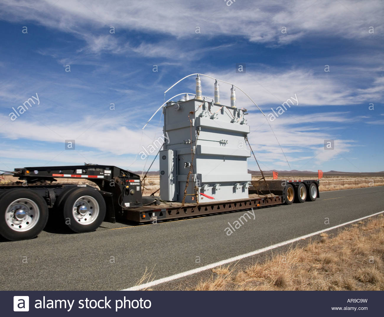 Truck hauling wide load oversize load over size load wideload electrical  transformer low boy lowboy trailer
