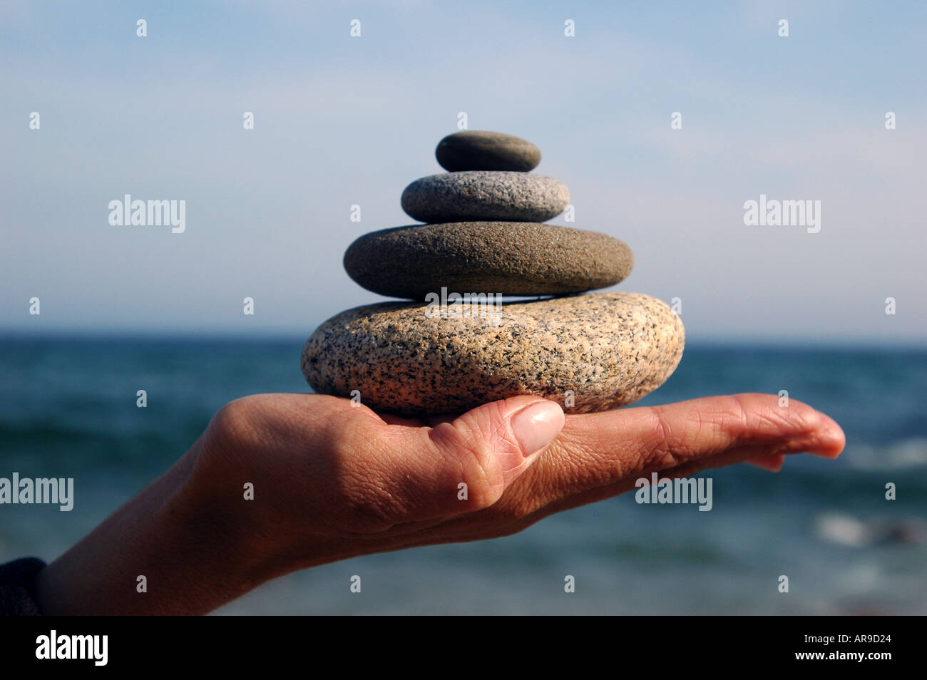 Relax yoga Hand with pile of rocks design and neatness - Stock Image