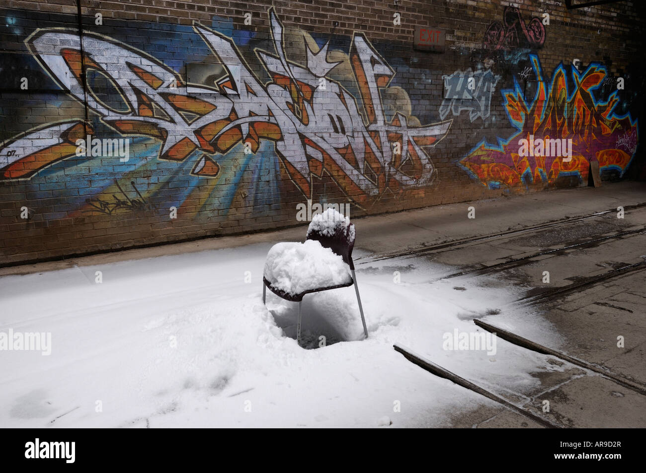Snow Covered Chair With Graffiti At Don Valley Brickworks Plant Toronto