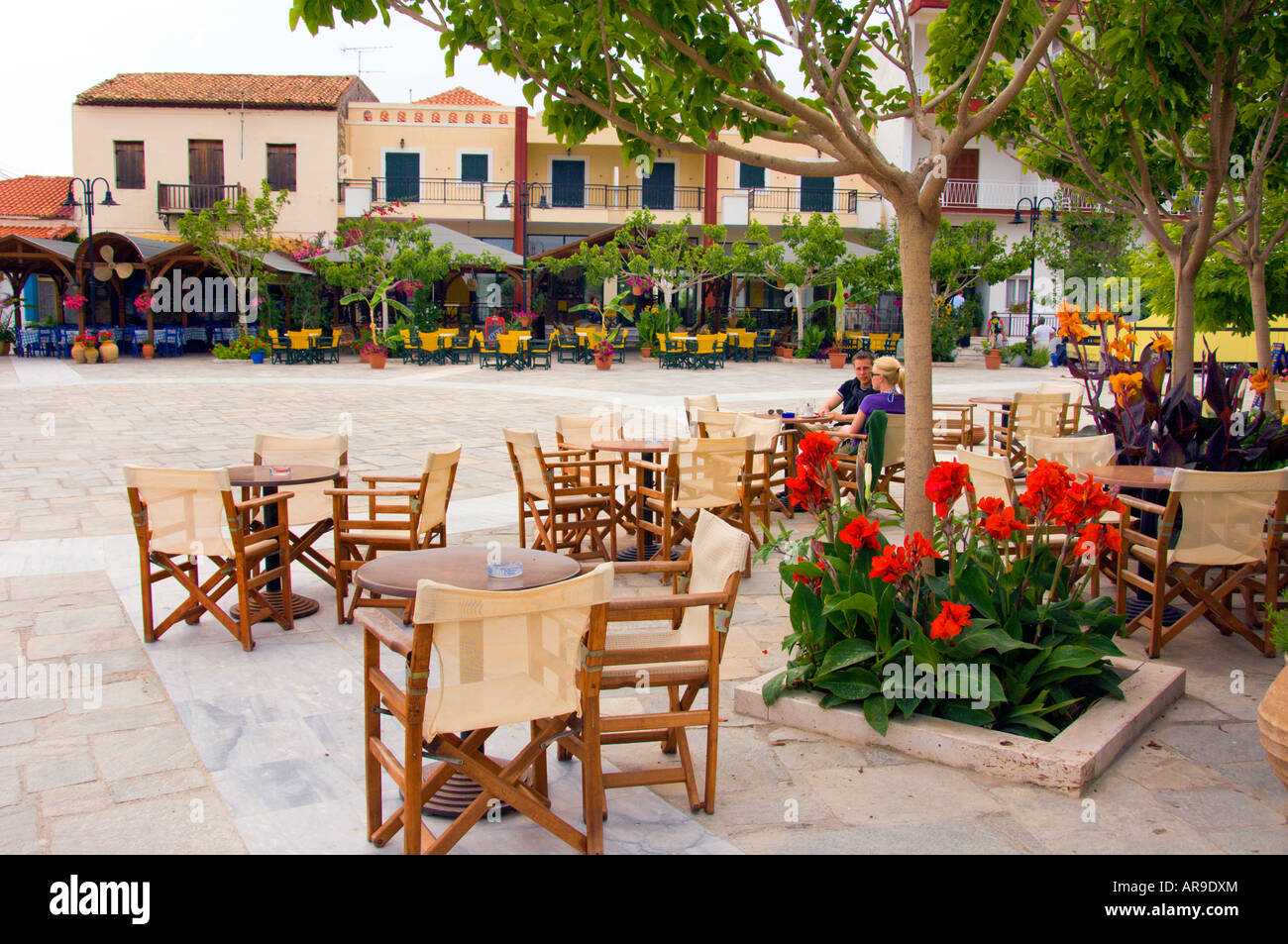 Outdoor restaurants at the town square in Methoni Messinia Peloponesse Greece - Stock Image