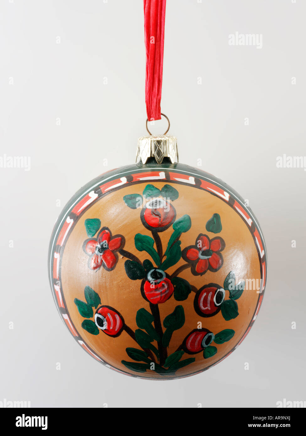 Traditional festive  hand painted Christmas decoration with folk design in green and red - Stock Image