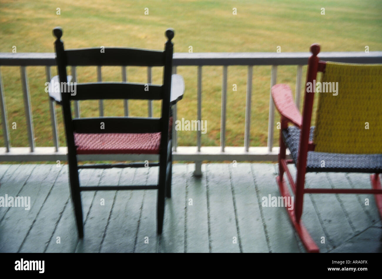 Soft Focus Two Rocking Chairs On Summer Cottage Porch