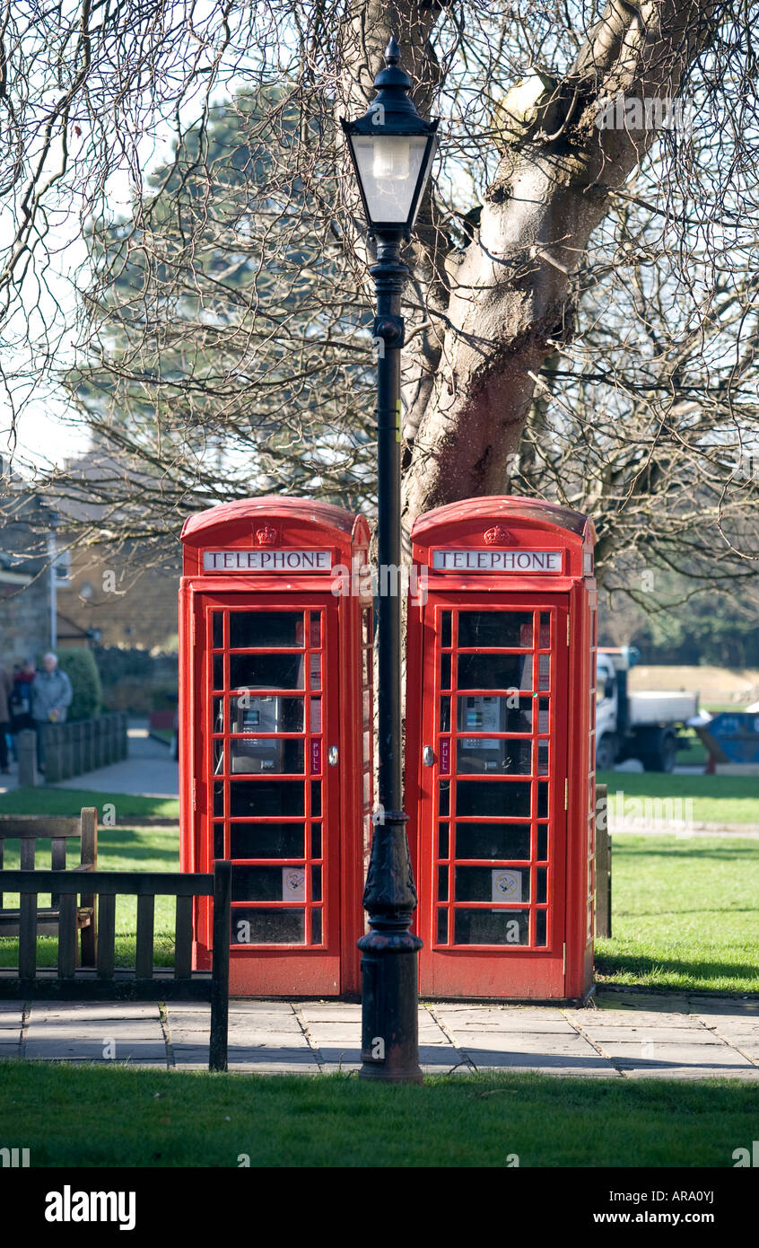 A pair of old red telephone boxes preserved in the Worcestershire village of Broadway England UK - Stock Image