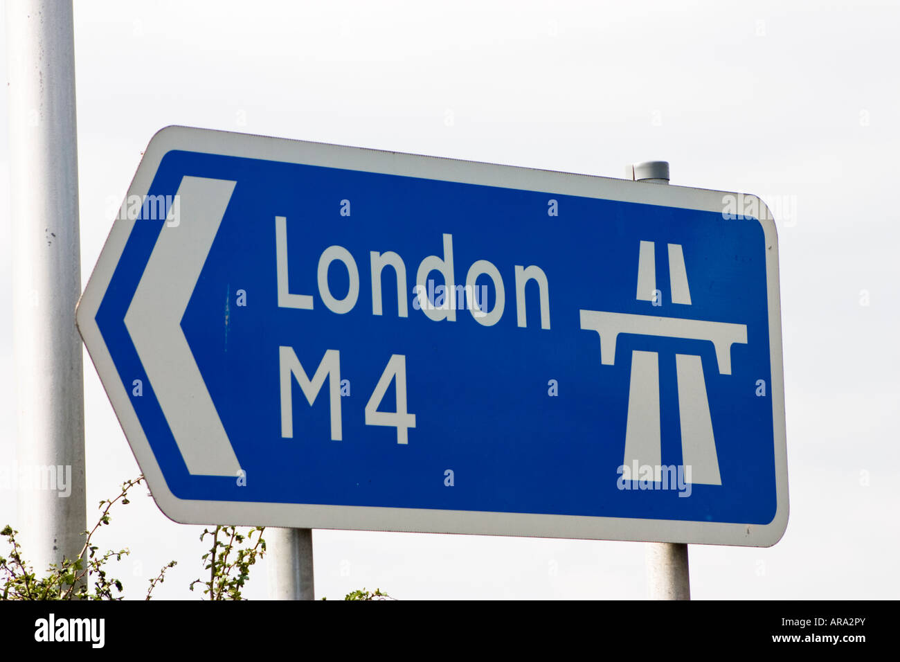 Road sign pointing east towards London at Junction 11 of the M4 motorway in Reading Berkshire Stock Photo