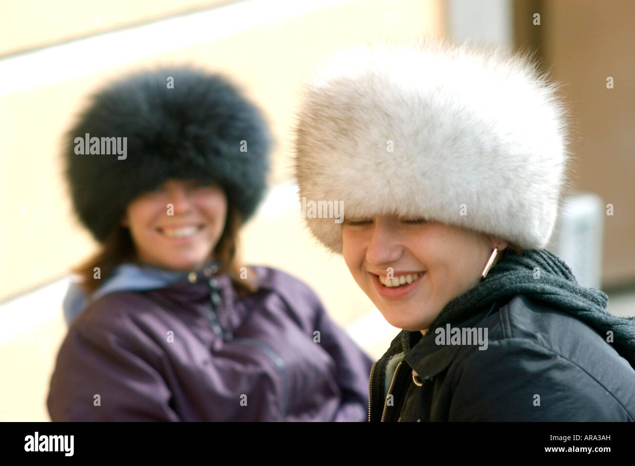 f7677e77adc Two young Russian women selling souvenirs while wearing the shapka or ushanka  fur hats or kulpas in Saint Petersburg Russia