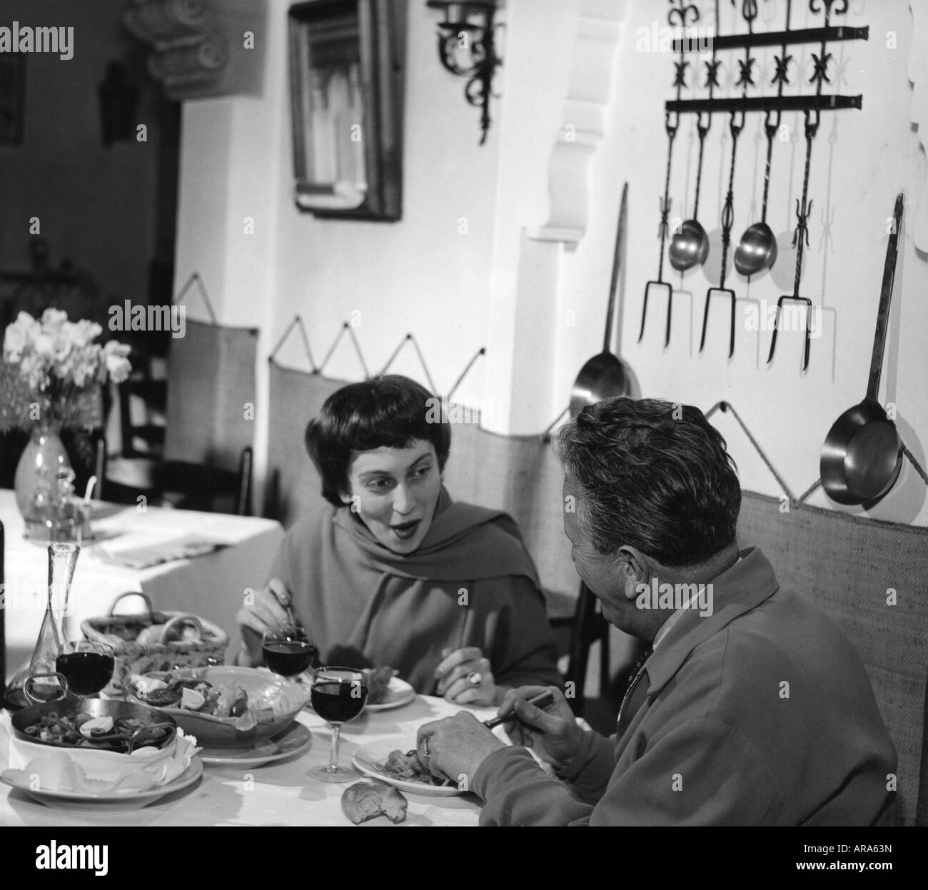 geography/travel, Germany, Munich, gastronomy, restaurant 'Madrid', interior view, guests eating, 1954, - Stock Image