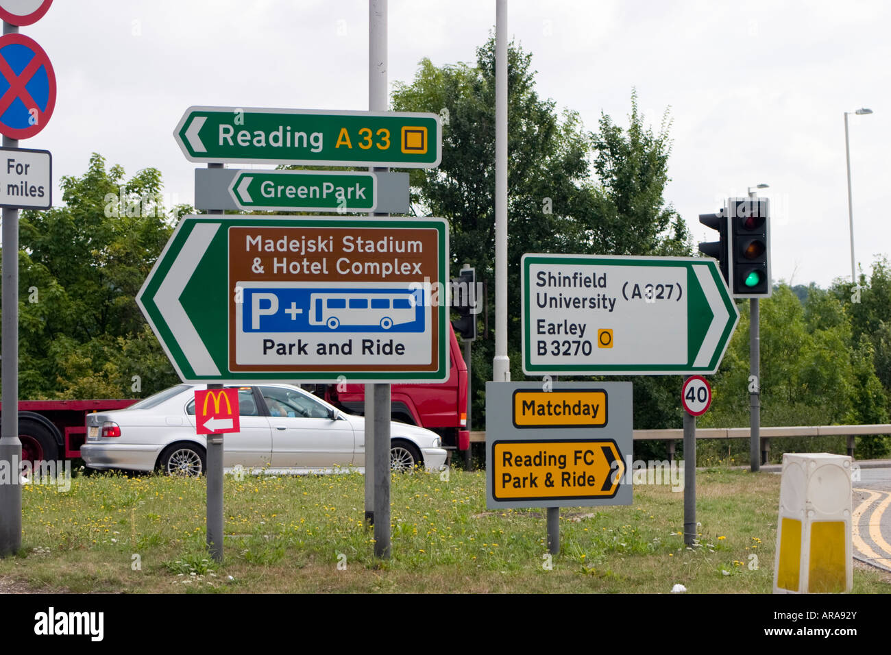 Directional signposts on Junction 11 of the M4 motorway in Reading Berkshire pointing north up the A33 Stock Photo