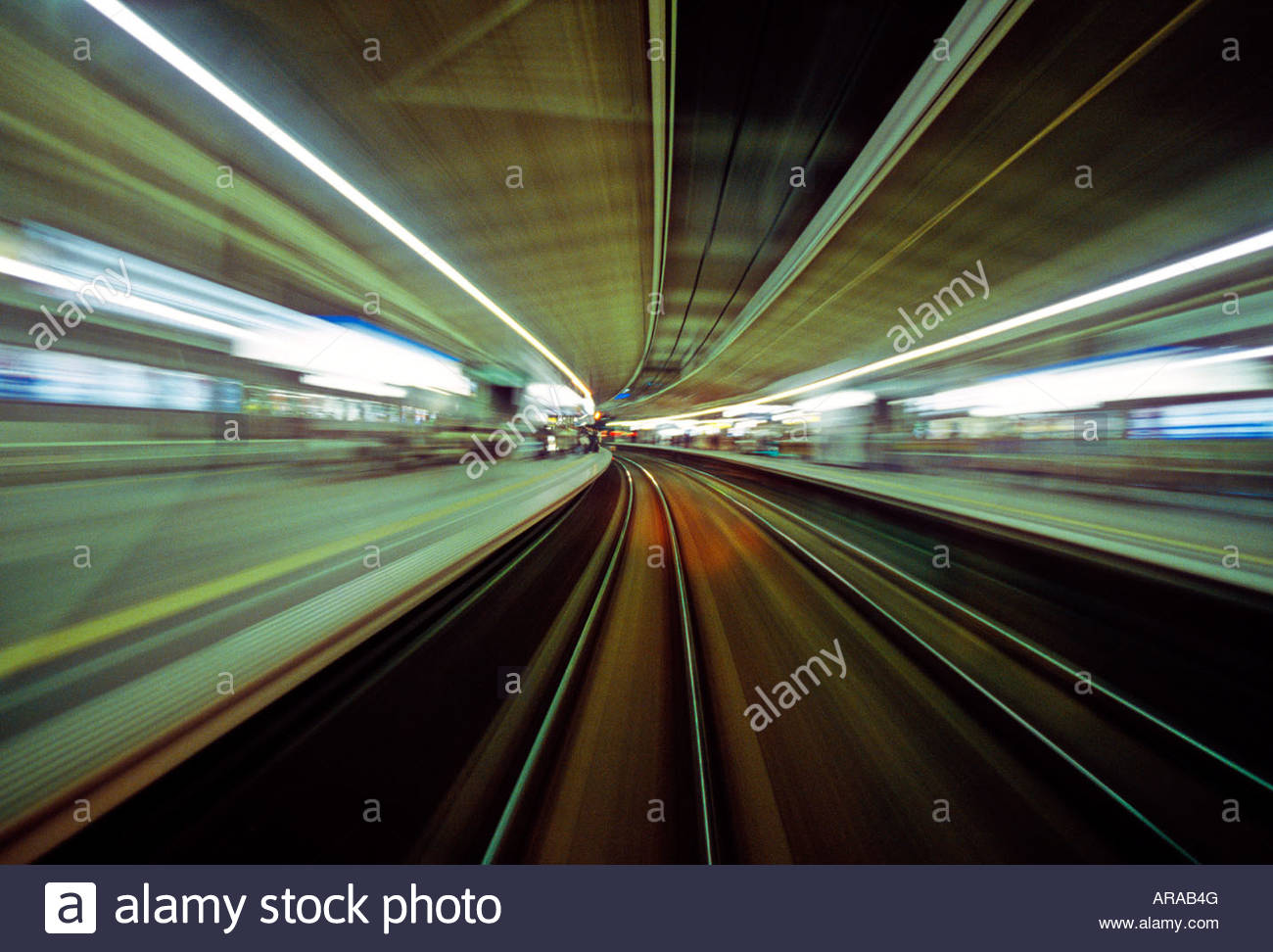 Impressionistic view from a speeding train passing through a station on the Odakyu line from Tokyo to Odawara, Japan - Stock Image