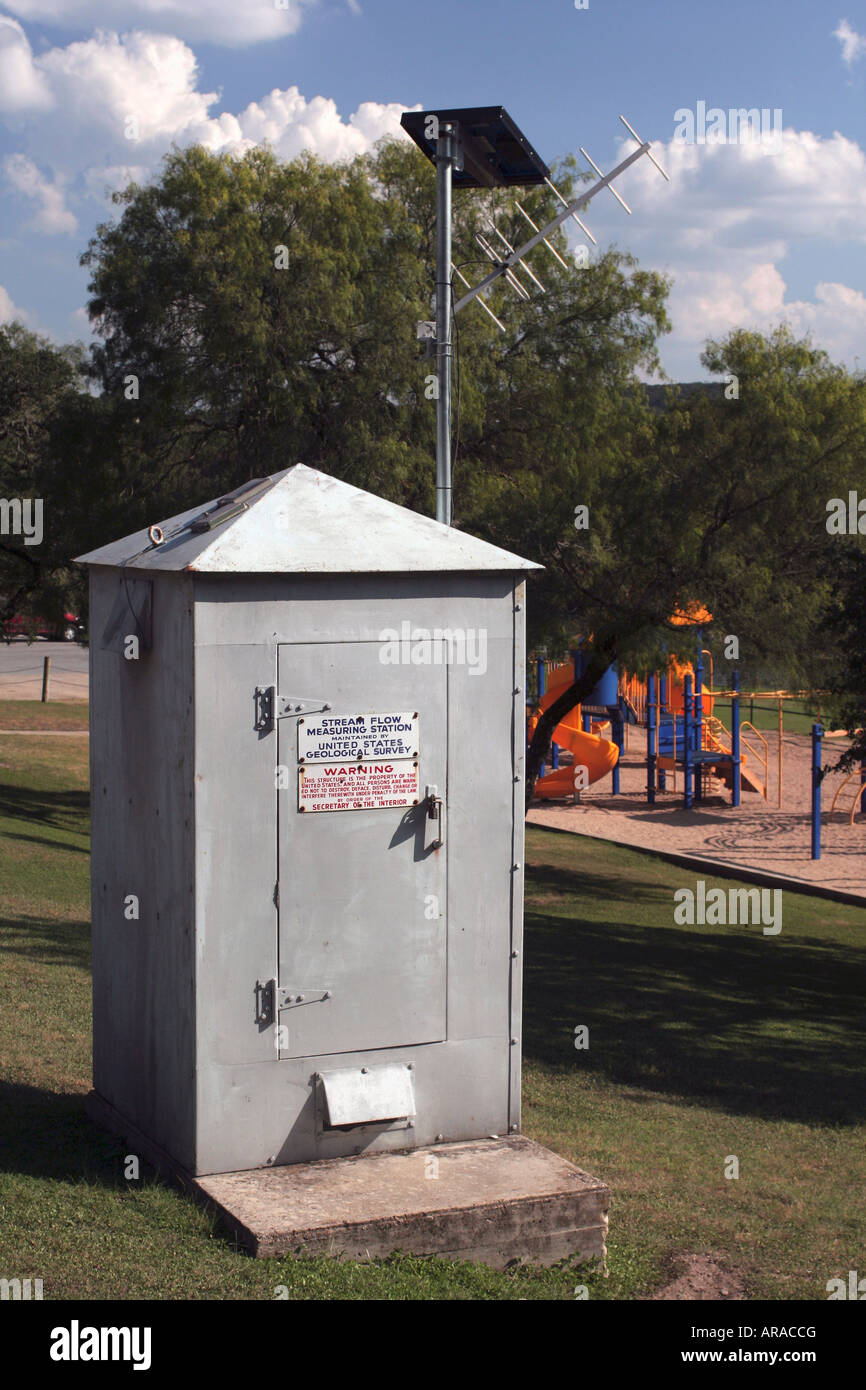USGS solar powered stream flow measuring station - Guadalupe River Kerrville Texas - Stock Image