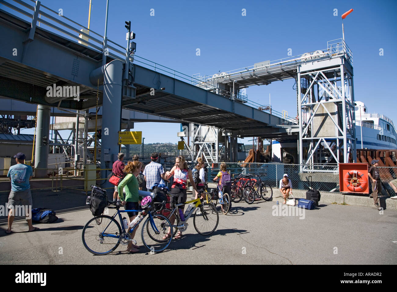 Cyclists and foot passengers waiting to leave on the BC Ferry at Horseshoe Bay Nanaimo Vancouver island Canada - Stock Image