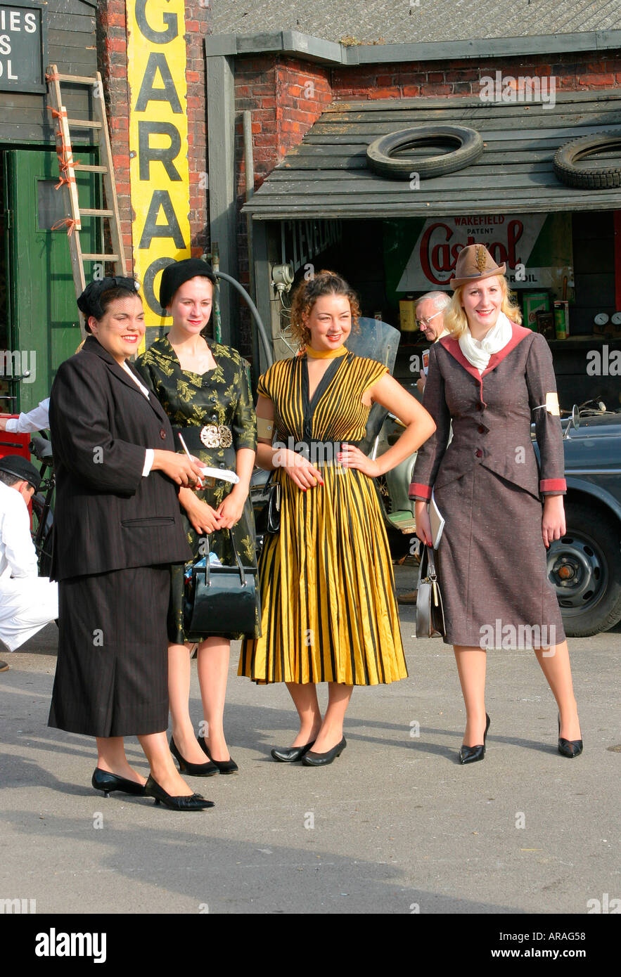Goodwood Revival meeting with visitors in costume - Stock Image
