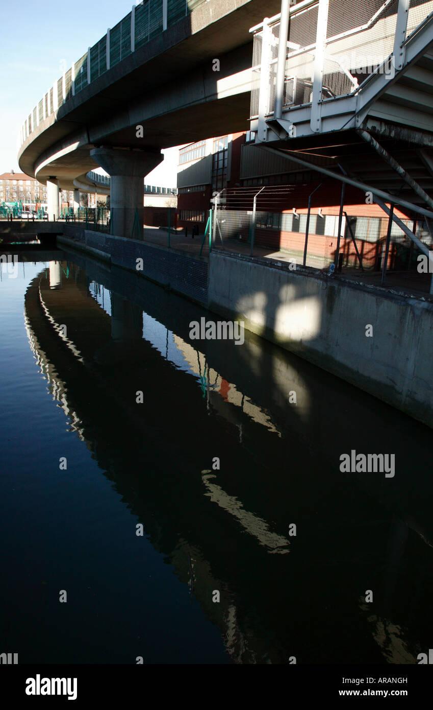 Deptford Bridge Docklands Light Railway Station and the Ravensbourne River - Stock Image