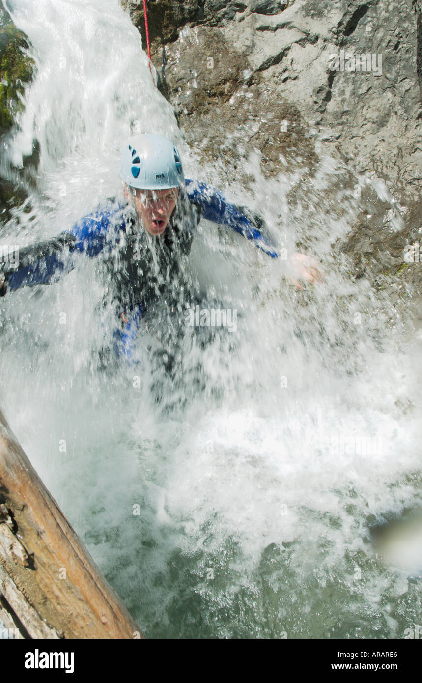 Man gets a soaking during a canyoning expedition in a gorge above the Lechtal Lech valley Tirol Austria - Stock Image