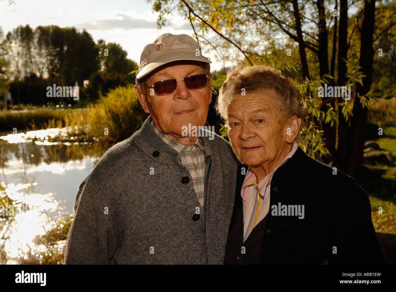 Old couple. Autumn. Sunshine. - Stock Image