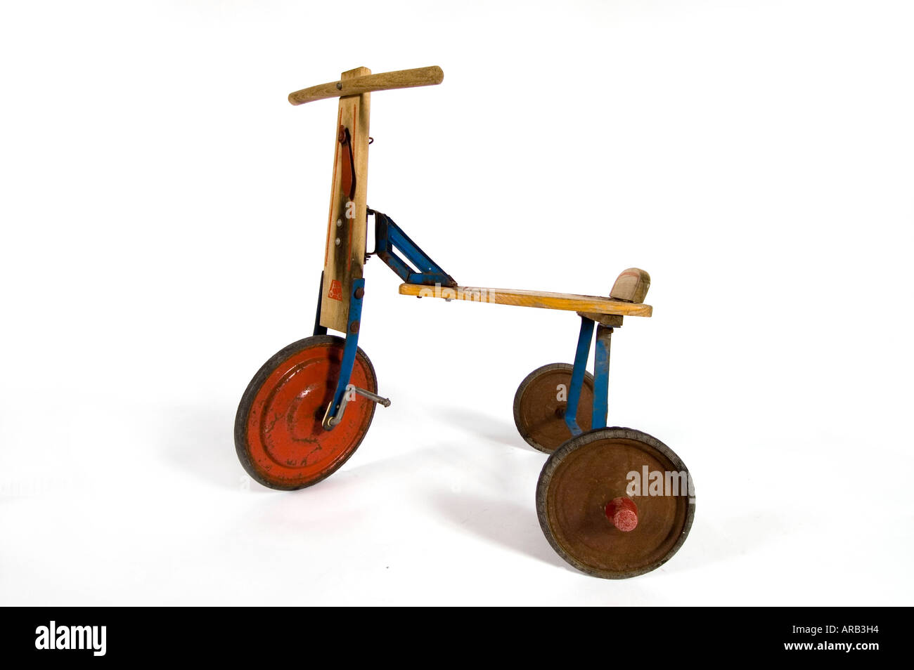 Side shot of a 1940 s child s tricycle on white background - Stock Image