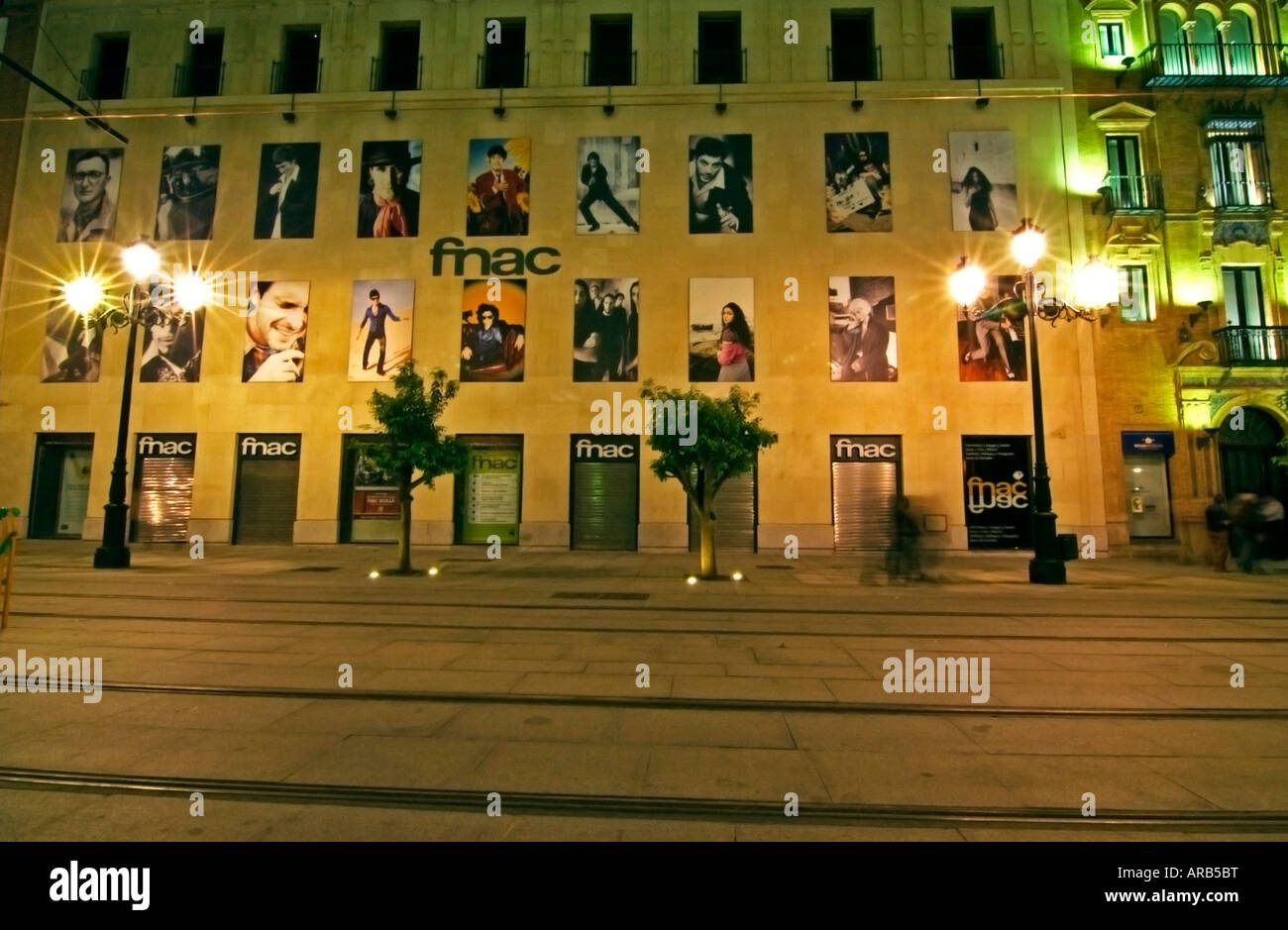 Wall with posters at night,Seville; province Andalucía; Spain - Stock Image