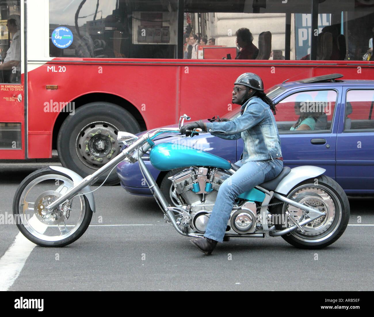 a biker on a modified chopper bike  in London - Stock Image