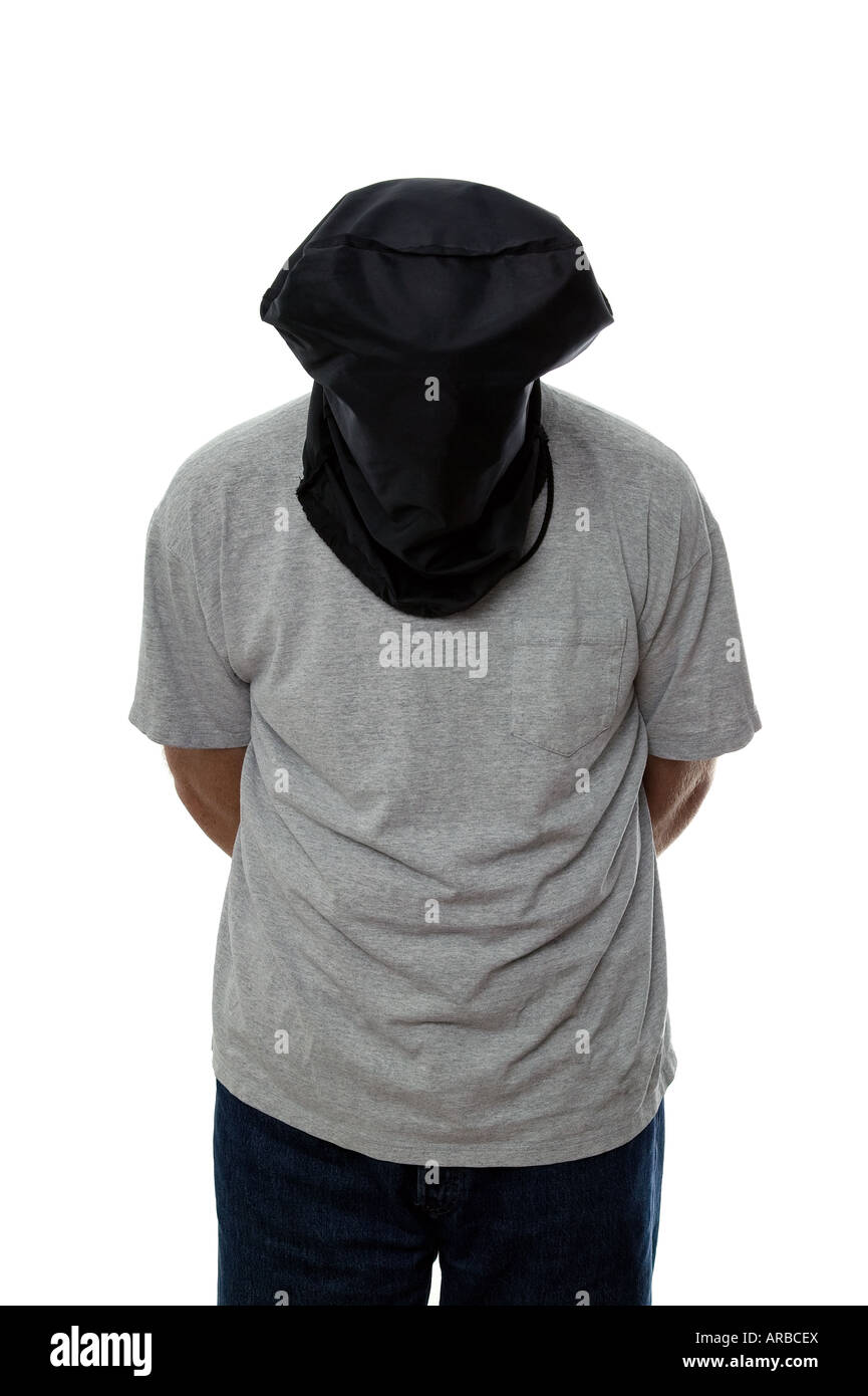 Man with a black hood over his head and his hands tied behind his back - Stock Image