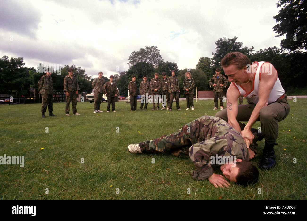 a soldier of the Royal Welsh Fusiliers demonstrates self defense to cadets - Stock Image