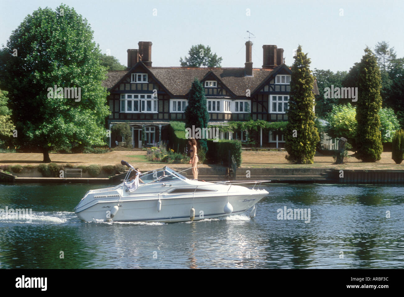 A motor cruiser on the River Thames at Remenham in Berkshire England UK Stock Photo