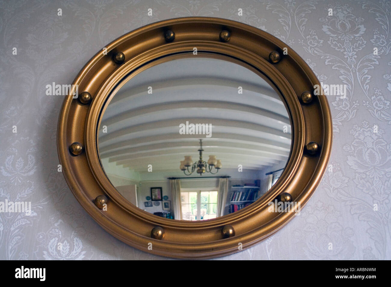 A Framed Convex Mirror - Stock Image