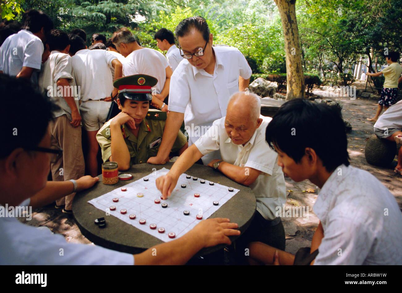 Men playing Chinese chess, Shanghai, China - Stock Image
