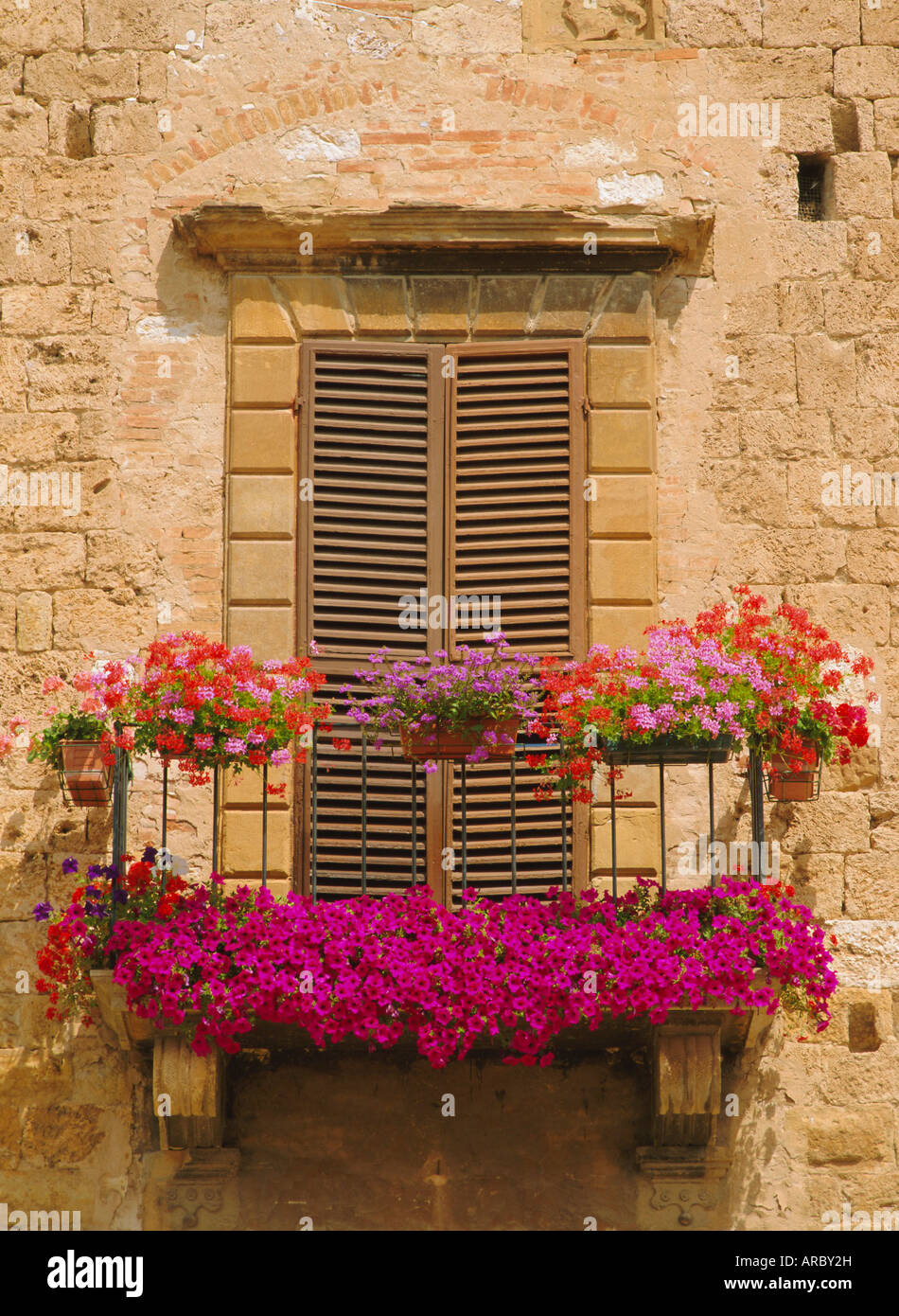 Flower covered balcony, Colle di Val d'Elsa, Tuscany, Italy - Stock Image