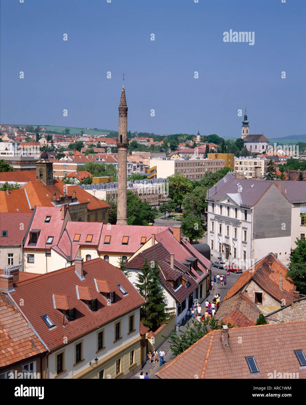 Houses, the Turkish minaret, and churches in the town of Eger, Hungary - Stock Image