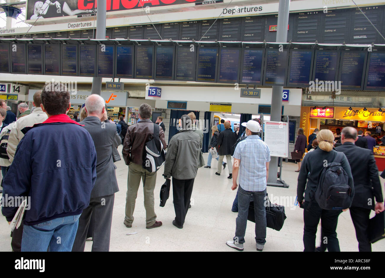 commuters waiting in Waterloo train Station London England UK travel delays - Stock Image
