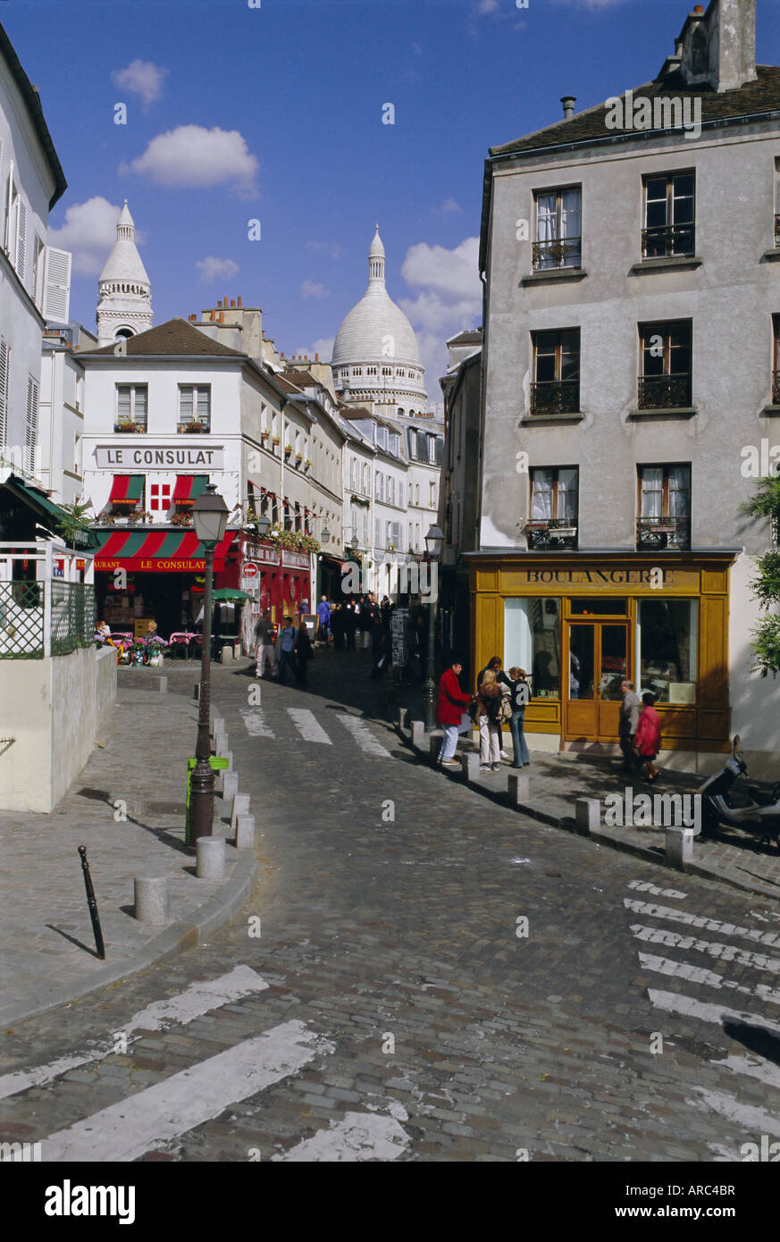 Street scene and the dome of the basilica of Sacre Coeur, Montmartre, Paris, France, Europe - Stock Image