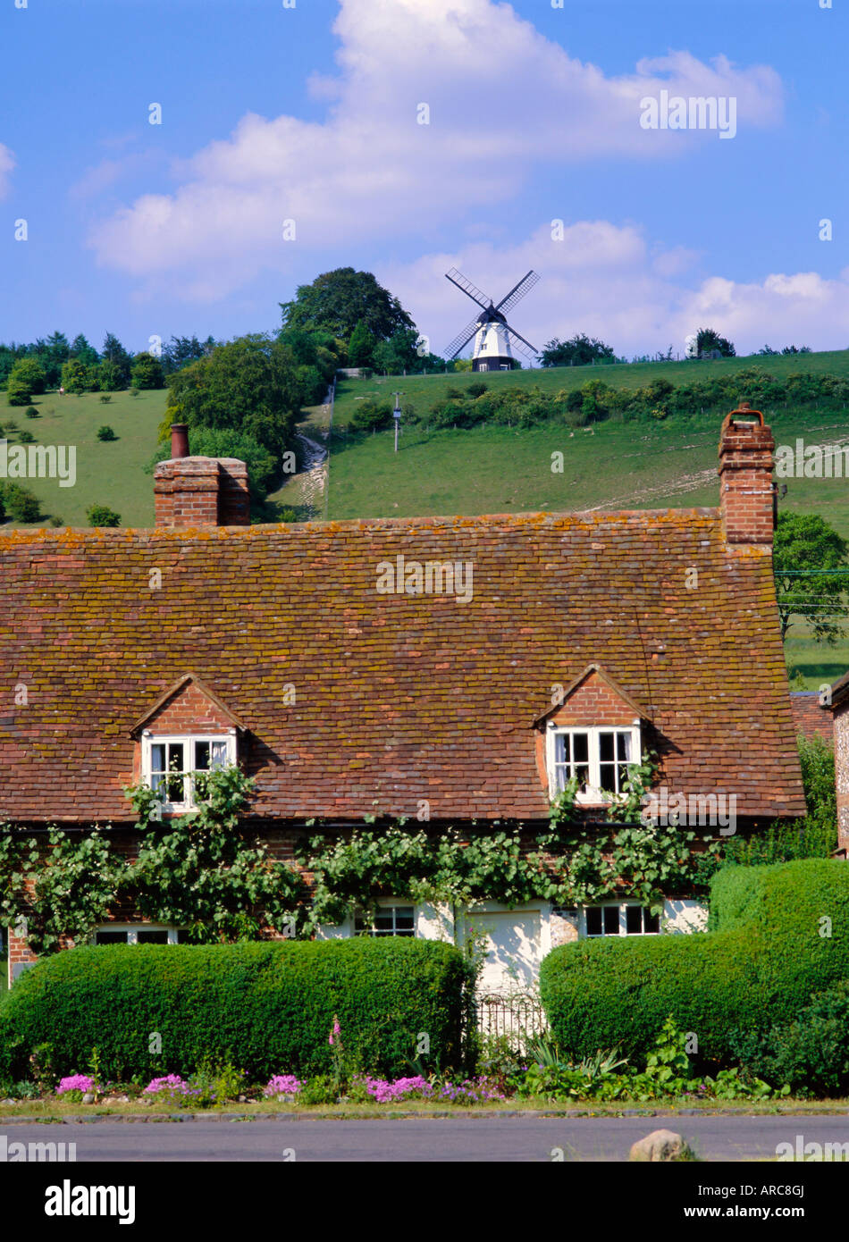 Windmill overlooking the village of Turville in the Chilterns, Buckinghamshire, England, UK, Europe - Stock Image
