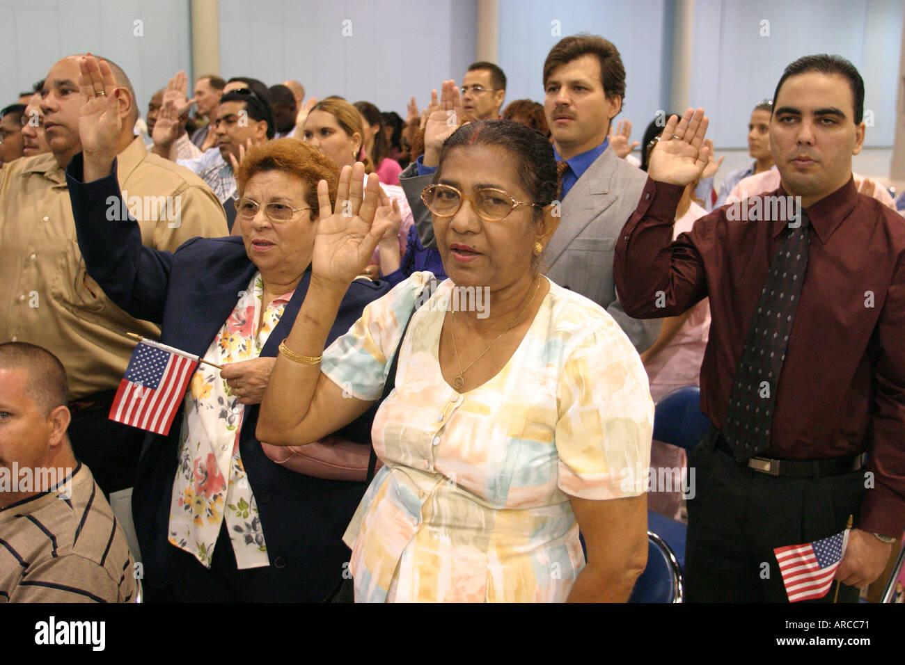 Miami Beach Florida naturalization ceremony oath of citizenship Pledge of Allegiance - Stock Image