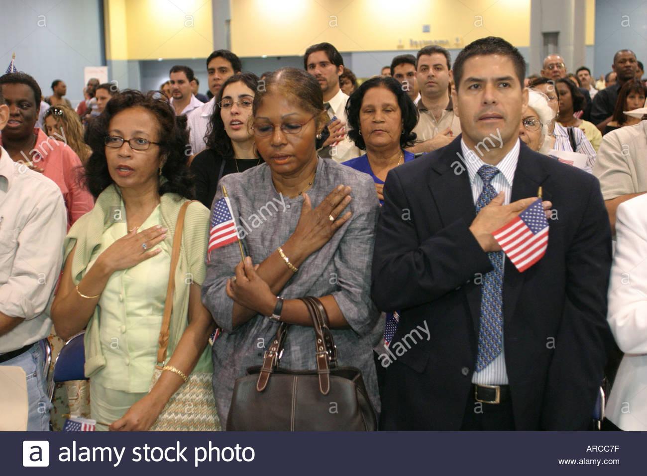 Miami Beach Florida naturalization ceremony oath of citizenship Pledge of Allegiance US flag - Stock Image