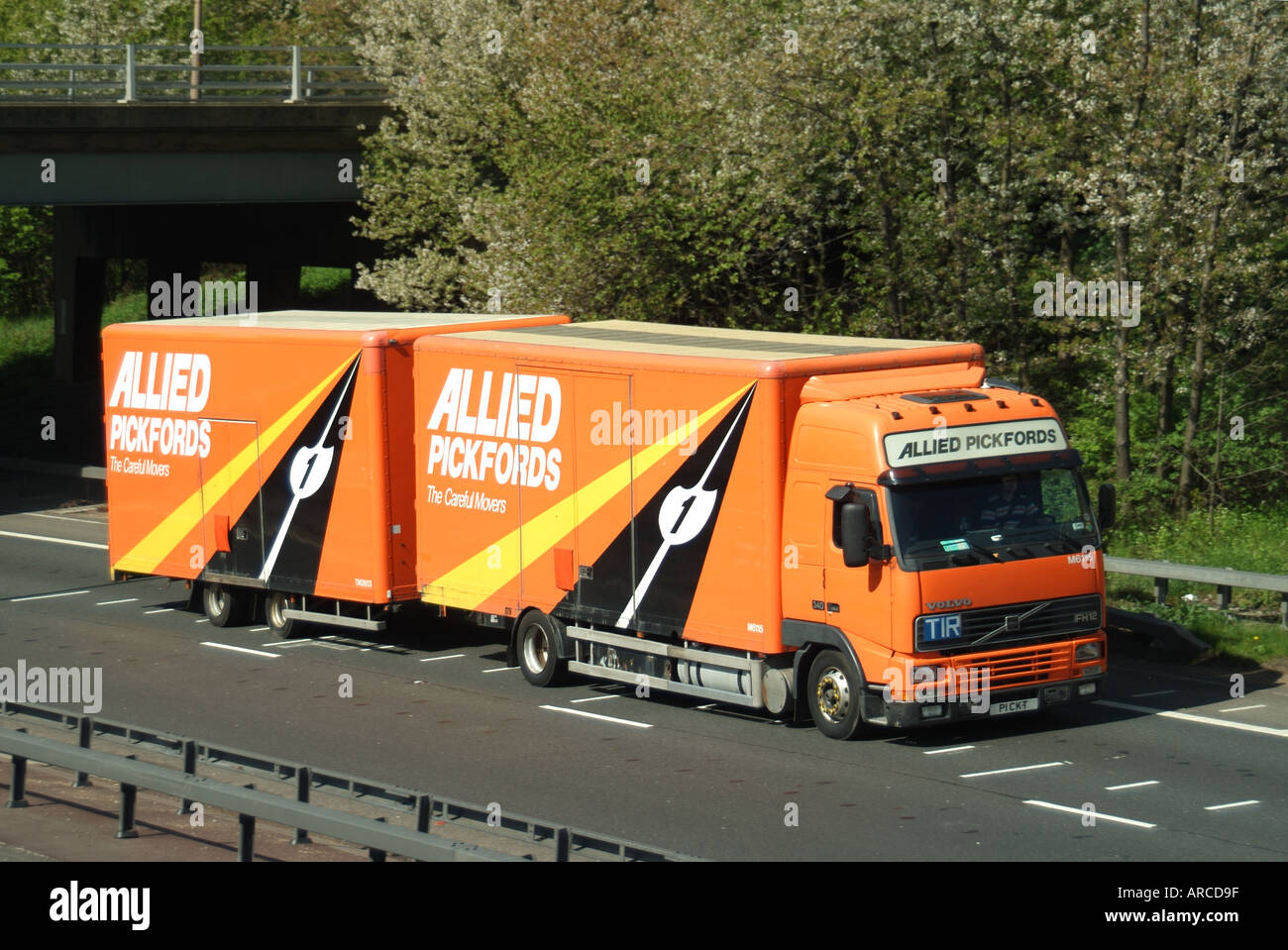 Allied Pickfords removals lorry and trailer on dual carriageway trunk road left hand drive A12 trunk road Brentwood Essex England UK Stock Photo