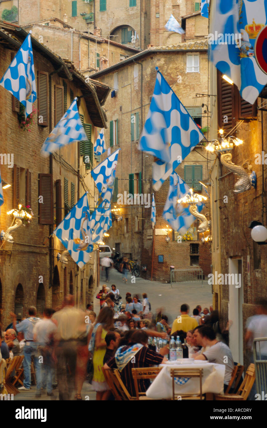 Palio banquet for members of the Onda (Wave) contrada, Siena, Tuscany, Italy, Europe - Stock Image