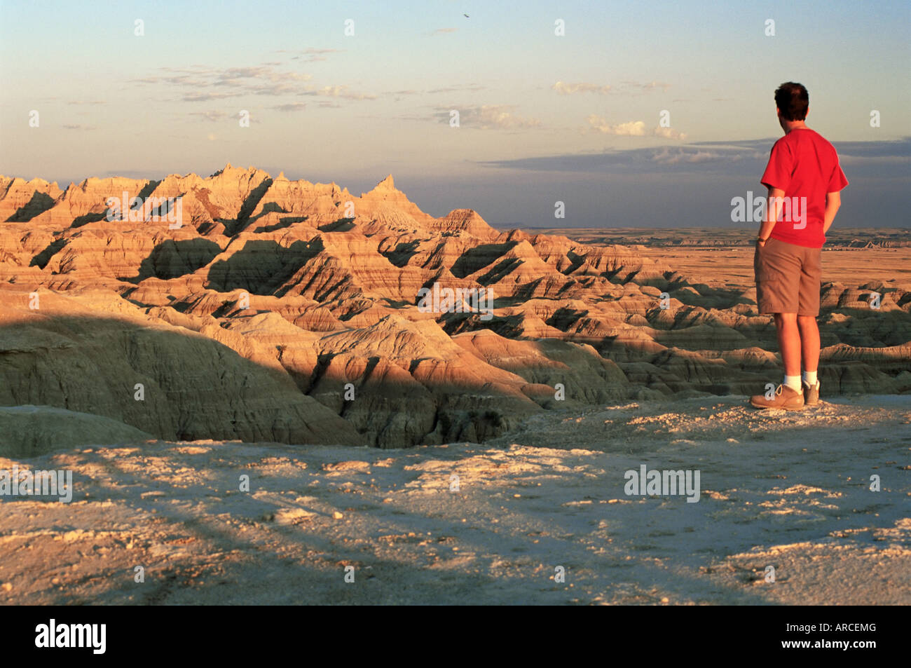 Visitor looking over rugged landscape from the Badlands Loop Road near Panorama Point, Badlands National Park, South Stock Photo